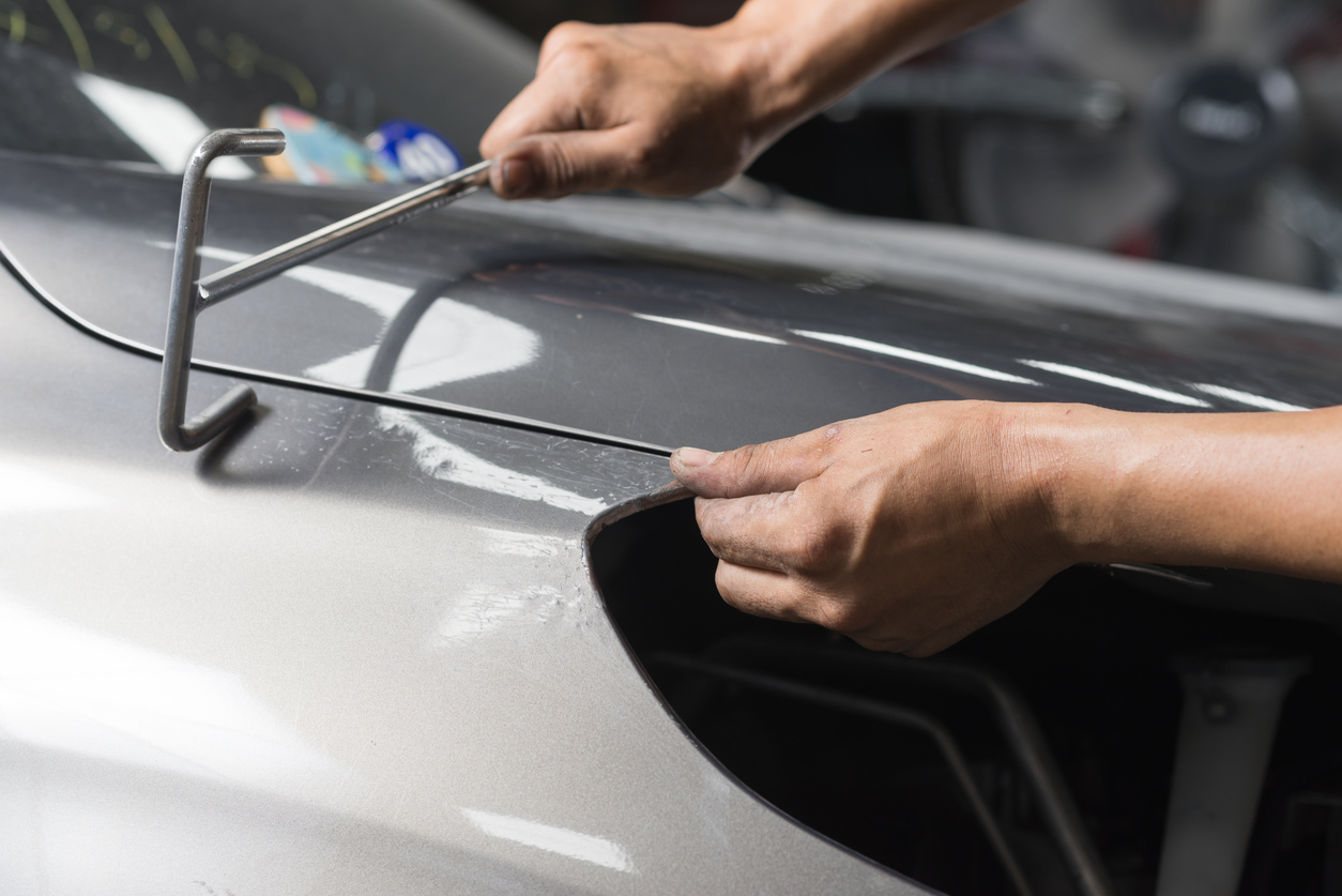 Different paintless dent removal techniques